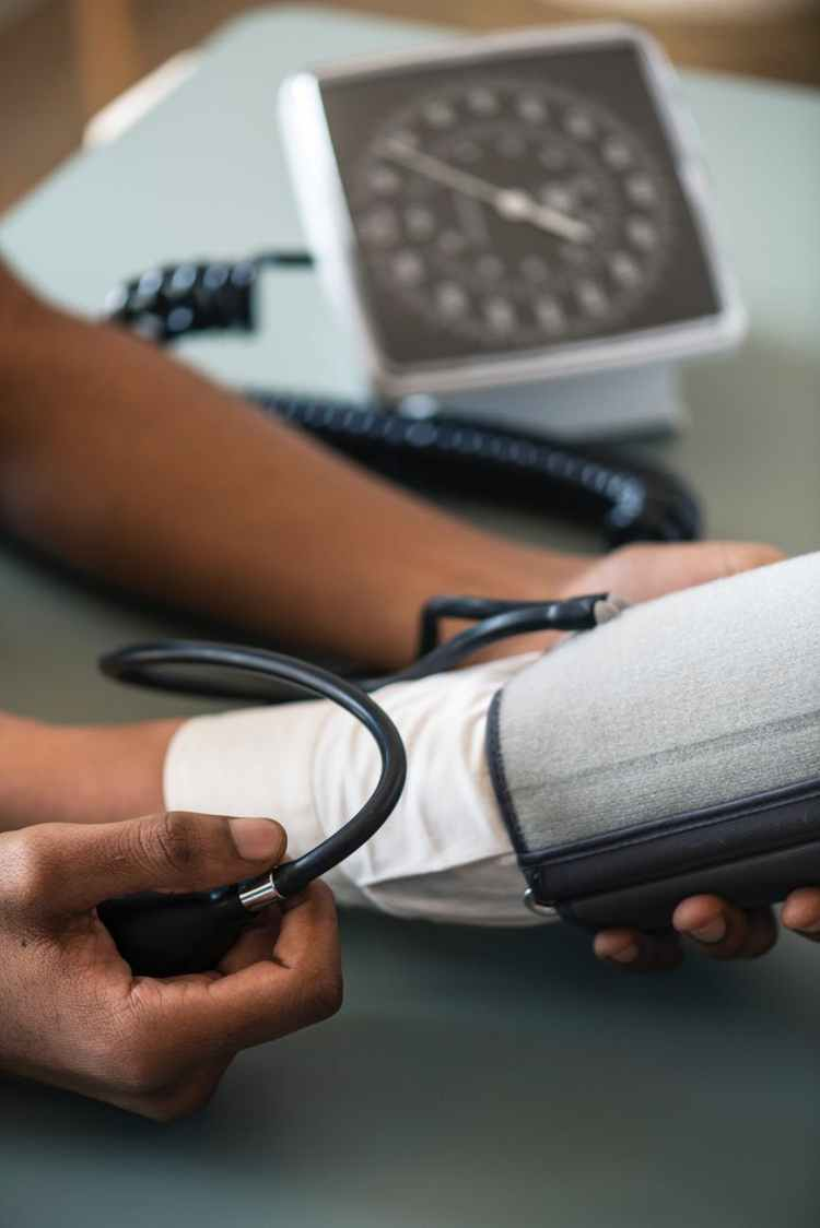 person taking blood pressure