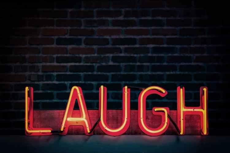 laugh neon light signage turned on